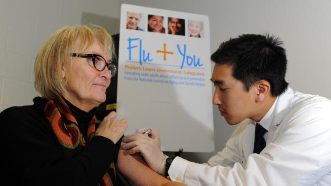 IMAGE DISTRIBUTED FOR NATIONAL COUNCIL ON AGING AND SANOFI PASTEUR - Pharmacist Jason To gives a flu shot to Diane Marie Dash during the Flu + You event at Montclair Recreation Center, sponsored by the National Council on Aging and Sanofi Pasteur on Tuesday, Oct. 22, 2013, in Denver. (Jack Dempsey / AP Images for National Council on Aging and Sanofi Pasteur)