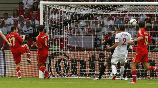 Russia's Alan Dzagoyev, left,  scores a goal  during the Euro 2012 soccer championship Group A match between Poland and Russia in Warsaw, Poland, Tuesday, June 12, 2012. (AP Photo/Michael Sohn)