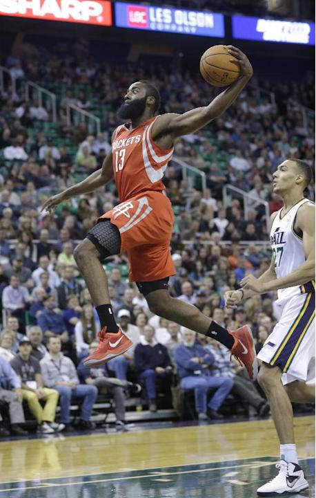 Houston Rockets' James Harden (13) goes to the basket as Utah Jazz's Rudy Gobert (27), of France, looks on in the first half during an NBA basketball game Saturday, Nov. 2, 2013, in Salt Lake City. Th
