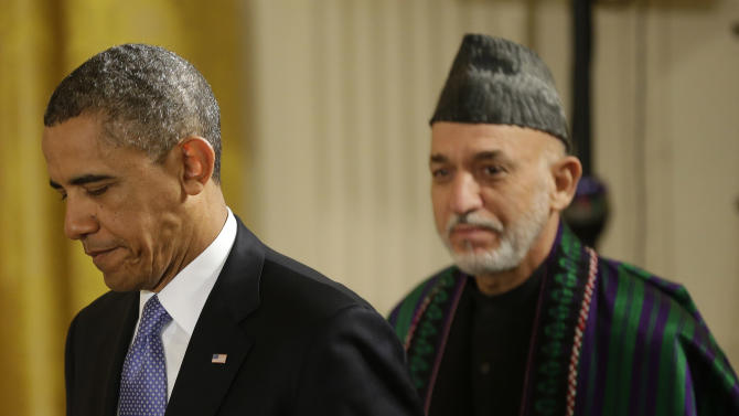 President Barack Obama and Afghan President Hamid Karzai arrive for their joint news conference in the East Room of the White House in Washington, Friday, Jan. 11, 2013. (AP Photo/Pablo Martinez Monsivais)
