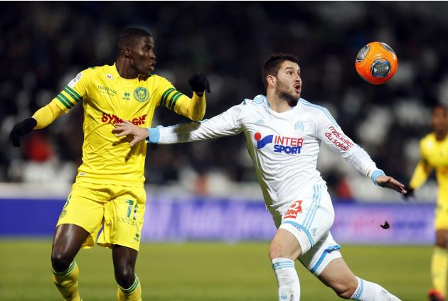 Olympique Marseille's Gignac challenges FC Nantes' Djilobodji during their French Ligue 1 soccer match at the Velodrome stadium in Marseille