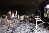 "The US consulate compound in Benghazi is seen after September 11 attack that killed four Americans. The US intelligence community said that a deadly assault on a US consulate in Libya was a planned attack linked to Al-Qaeda, though it stressed that ""many unanswered questions"" remained"