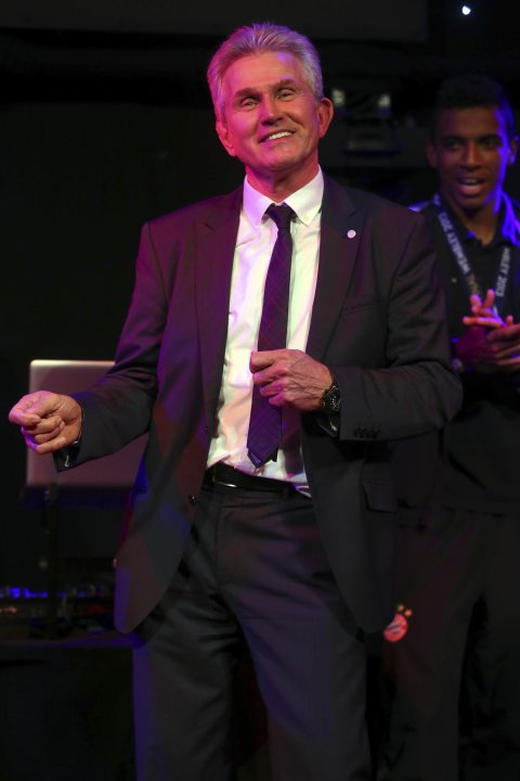 Bayern Munich coach Jupp Heynckes dances at the team's banquet in London
