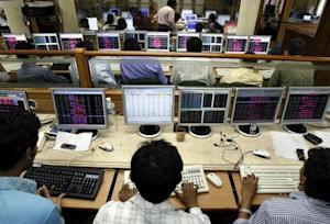 Stockbrokers monitor stock index numbers at a brokerage firm in Mumbai