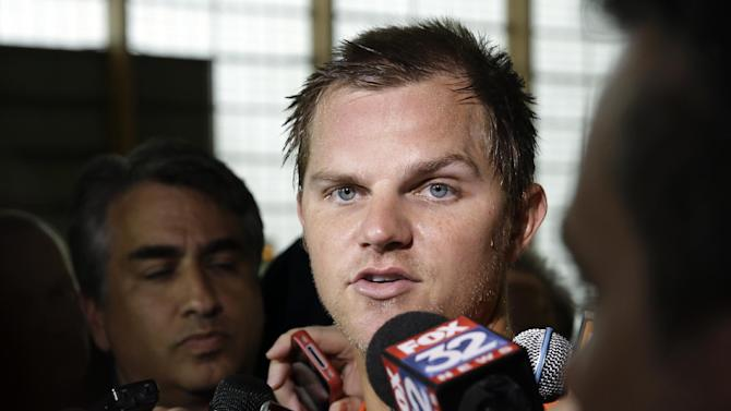 Chicago Bears quarterback Jimmy Clausen (8) talks to media after the Bears' NFL football practice in Lake Forest, Ill., Wednesday, June 11, 2014