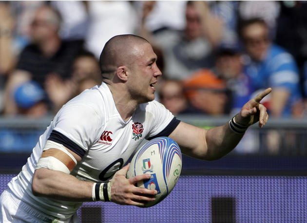 England's Mike Brown celebrates after scoring a try during the Six Nations Rugby Union match between Italy and England at Rome's Olympic stadium, Saturday, March 15, 2014. (AP Photo/Gregorio B