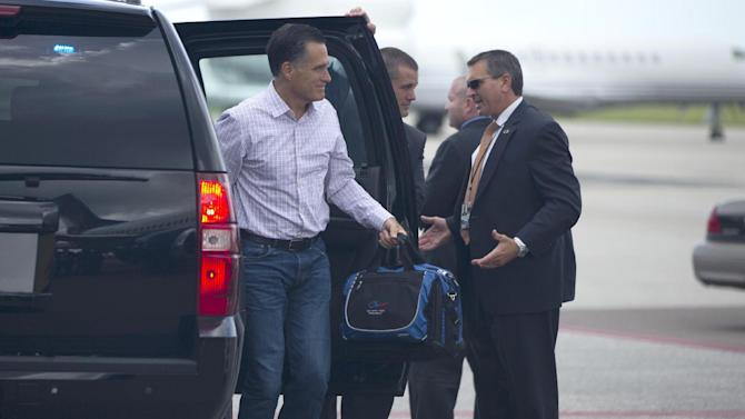 Republican presidential candidate, former Massachusetts Gov. Mitt Romney arrives at the Tampa International Jet Center in Tampa, Fla., Wednesday, Aug. 29, 2012,  for a campaign trip to Indianapolis.  (AP Photo/Evan Vucci)