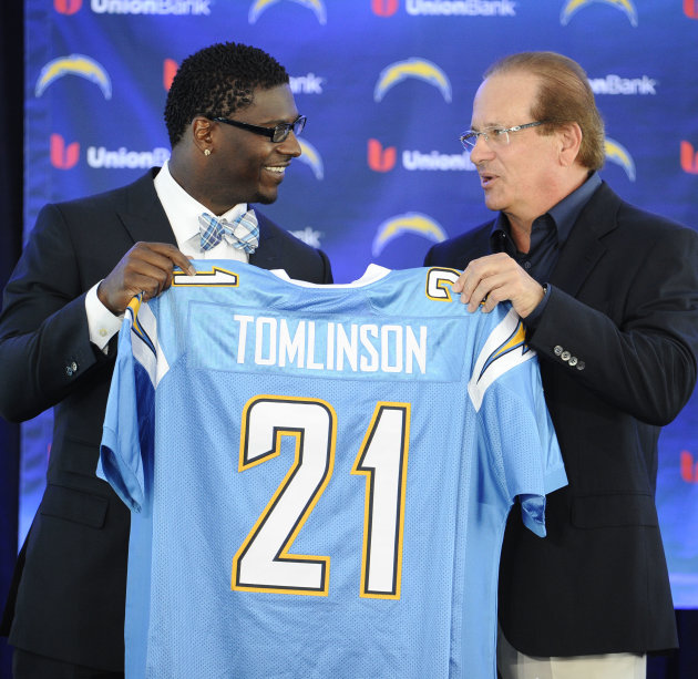 Former San Diego Chargers running back LaDainian Tomlinson, left, and Chargers president Dean Spanos hold up Tomlinson's #21 jersey at a news conference held at the San Diego Chargers facility Monday,