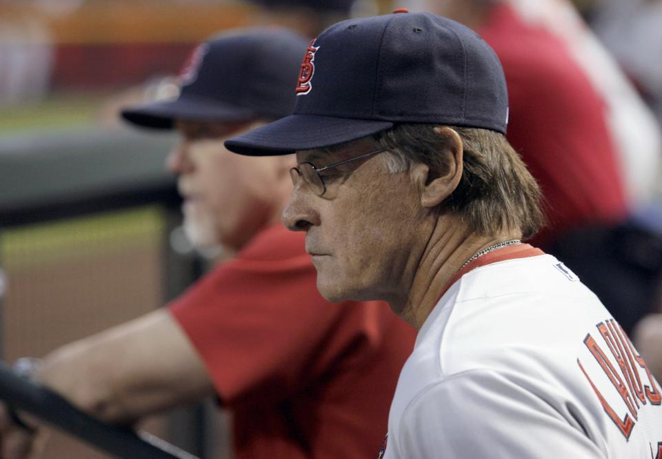St. Louis Cardinals manager Tony La Russa, right, and batting coach Mark McGwire, left, watch their team from the dugout in the second inning of a baseball game against the Arizona Diamondbacks on Monday, April 11, 2011, in Phoenix. (AP Photo/Paul Connors)