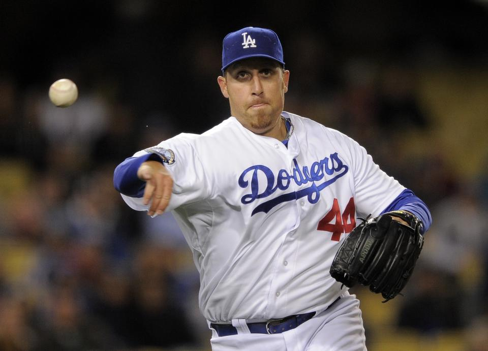 Los Angeles Dodgers starting pitcher Aaron Harang throws out San Diego Padres' Orlando Hudson at first during the seventh inning of their baseball game, Friday, April 13, 2012, in Los Angeles. (AP Photo/Mark J. Terrill)