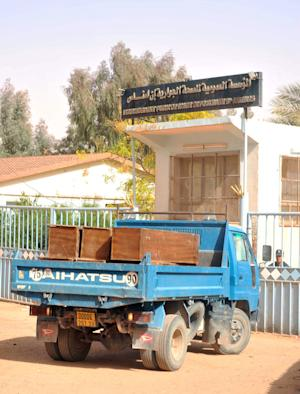 A truck loaded with empty coffins waits at the main entrance of the hospital where the bodies of persons killed during the hostage situation in a gas plant are gathered in Ain Amenas, Monday, Jan. 21, 2013. At least 81 people have been reported dead, including 32 Islamist militants, after a bloody, four-day hostage situation at Algeria's remote Ain Amenas natural gas plant. (AP Photo/Anis Belghoul)