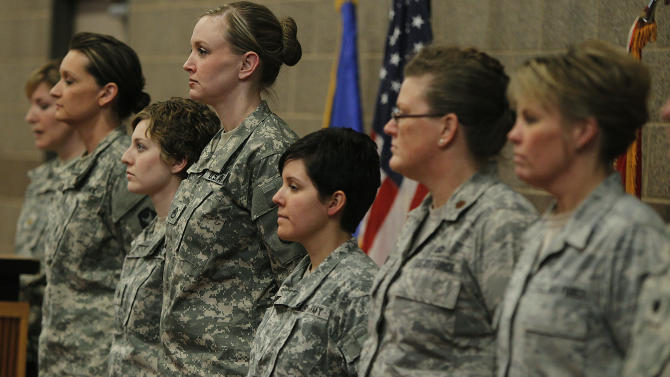 Kristen Auge, Deputy Director of Public Affairs, introduces soldiers from left, Army Sgt. 1st Class Katie Reed, Army Sgt. Cassie Mecuk, Army Staff Sgt. Andrea Drost, Army Sgt. Katie Warden, Air Force Maj. Ann Todd, and Air Force Master Sgt. Holly Caroon at the Inver Grove Heights, Minn., Training and Community Center following Secretary of Defense Leon E. Panetta's and Chairman of the Joint Chiefs of Staff General Martin E. Dempsey's announcement regarding women in combat. The Minnesota National Guard says it will integrate female soldiers into previously all-male combat infantry units. (AP Photo/The Star Tribune, Elizabeth Flores)  MANDATORY CREDIT; ST. PAUL PIONEER PRESS OUT; MAGS OUT; TWIN CITIES TV OUT