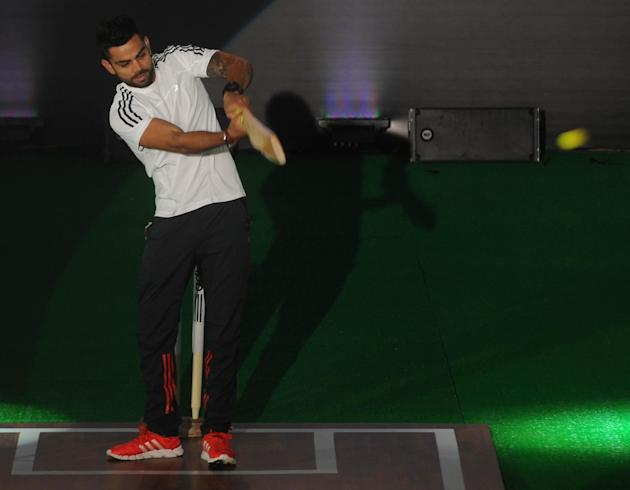 Indian Cricketer Virat Kohli at a promotional event of a sporting goods manufacturing company at Talkatora Stadium in New Delhi on Oct. 3, 2013. (Photo: IANS)