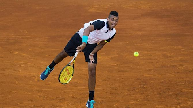 FILE - In this May 6, 2015, file photo, Nick Kyrgios, from Australia, serves during his Madrid Open tennis tournament match against Roger Federer in Madrid, Spain. (AP Photo/Andres Kudacki, File)