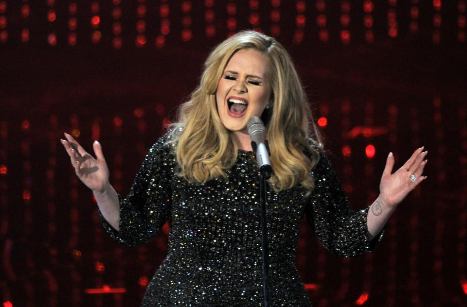Singer Adele performs during the Oscars at the Dolby Theatre on Sunday Feb. 24, 2013, in Los Angeles.  (Photo by Chris Pizzello/Invision/AP)