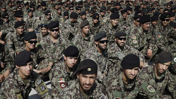 Afghan soldiers attend the hand over ceremony of U.S.- run prison to Afghan government in Bagram north of Kabul, Afghanistan, Monday, Sept. 10, 2012. U.S. officials handed over formal control of Afghanistan's only large-scale U.S.-run prison to Kabul on Monday, even as disagreements between the two countries over the thousands of Taliban and terror suspects held there marred the transfer. (AP Photo/Musadeq Sadeq)