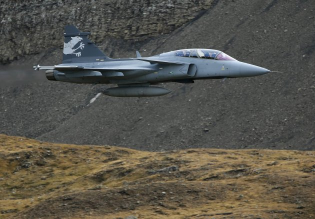 A Swedish Saab Gripen fighter jet performs during a flight demonstration of the Swiss Air Force over the Axalp