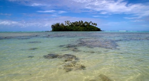 An island dots Muri beach on the Island of Rarotonga, the largest island in the Cook Islands
