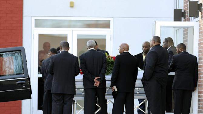 A coffin with the body of Kansas City Chiefs' Jovan Belcher is placed in a hearse after a service at the Landmark International Deliverance and Worship Center, Wednesday, Dec. 5, 2012, in Kansas City, Mo. Belcher shot his girlfriend, Kasandra Perkins, at their home Saturday morning before driving to Arrowhead Stadium and turning the gun on himself. (AP Photo/Ed Zurga)