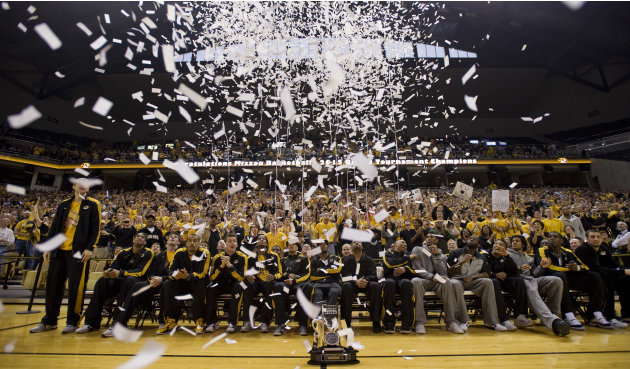 Confetti shoots over the Missouri basketball team as they watch their team get picked as a #2 seed in the West Region during their NCAA Tournament selection party in Mizzou Arena Sunday, March 11, 201
