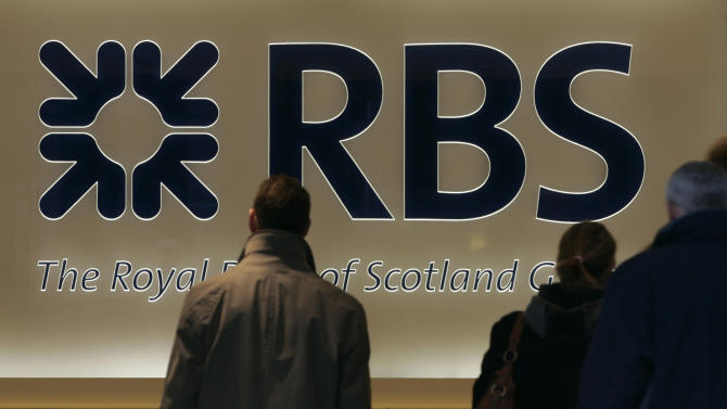 FILE - In this Thursday, Feb. 26, 2009 file photo the logo for the Royal Bank of Scotland is seen as people enter their headquarters in London.  The value of global mergers and acquisitions deals in 2012 was nearly half the amount made five years ago, when the global financial crisis was first baring its teeth, a leading accounting and consulting firm said Wednesday, Dec. 12, 2012. There were a little under 37,000 deals worldwide, around 9,000 less than in 2007, when many companies indulged in a feverish bout of deal-making, many of which led to their financial ruin. Much of the blame for Royal Bank of Scotland PLC's near-collapse in 2008, which eventually required a government bailout, was due to its over-priced purchase of a large chunk of Dutch bank ABN Amro the year before. (AP Photo/Alastair Grant, File)