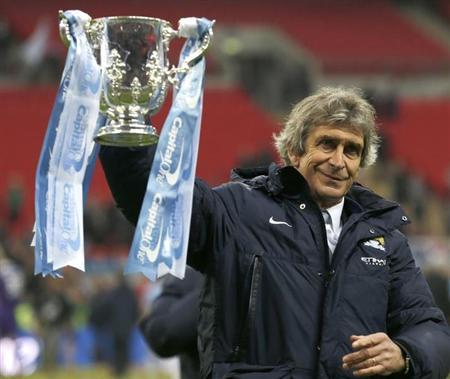 Manchester City manager Pellegrini holds aloft the trophy after winning their English League Cup final soccer match against Sunderland at Wembley Stadium in London