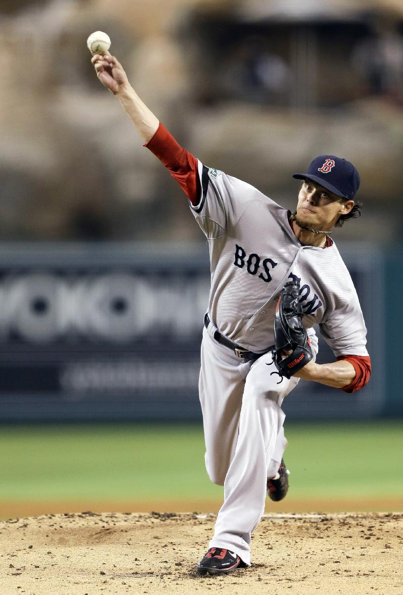 Boston Red Sox starting pitcher Clay Buchholz throws to the Los Angeles Angels during the first inning of an baseball in Anaheim, Calif., Tuesday, Aug. 28, 2012. (AP Photo/Chris Carlson)