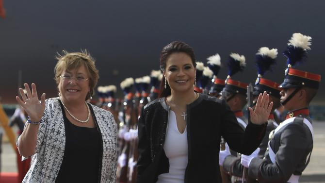 Chile's President Bachelet waves next to Guatemalan Vice President Baldetti during a reception in Guatemala City