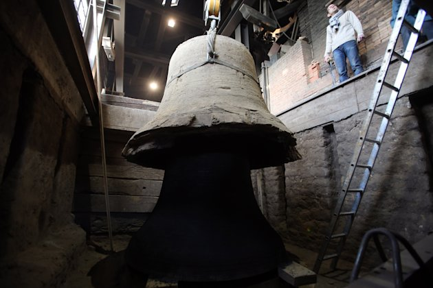 "The new bell bound for Notre Dame cathedral in Paris, ""Gabriel"" appears as the cope mould is lifter clear after being cast in the foundry of Villedieu les Poeles, Normandy, France, Friday, Dec. 7, 201"