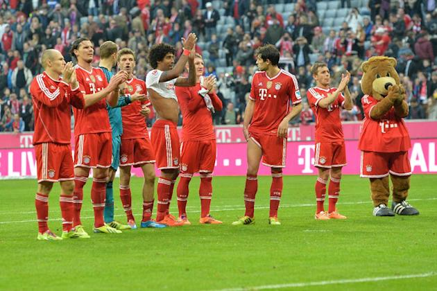 Bayern's players celebrates to supporters after the German first division Bundesliga soccer match between FC Bayern Munich and SC Freiburg in Munich, Germany, on Saturday, Feb. 15, 2014. Bayern wo