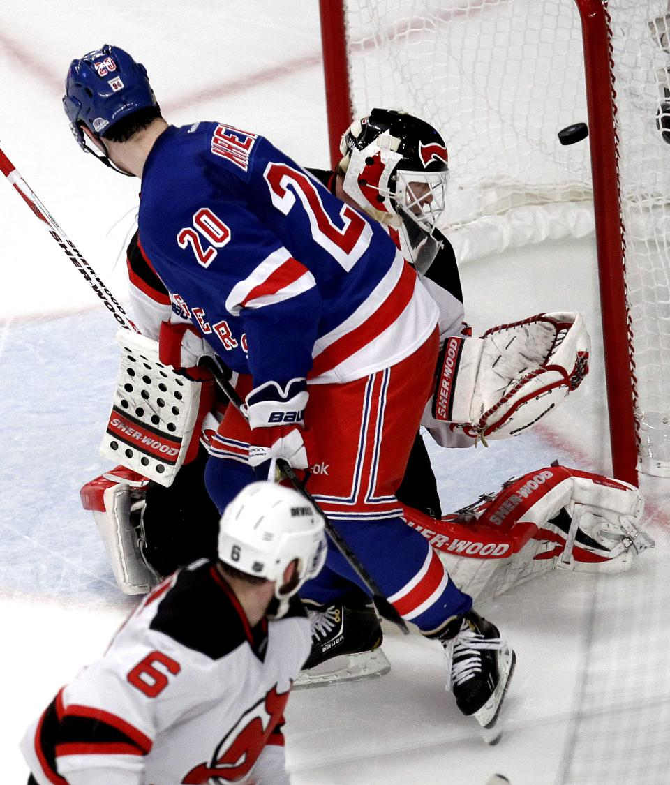 New York Rangers' Chris Kreider (20) scores on New Jersey Devils goalie Martin Brodeur, rear, during the second period of Game 2 of an NHL hockey Stanley Cup Eastern Conference final playoff series, Wednesday, May 16, 2012, at New York's Madison Square Garden. (AP Photo/Julio Cortez)
