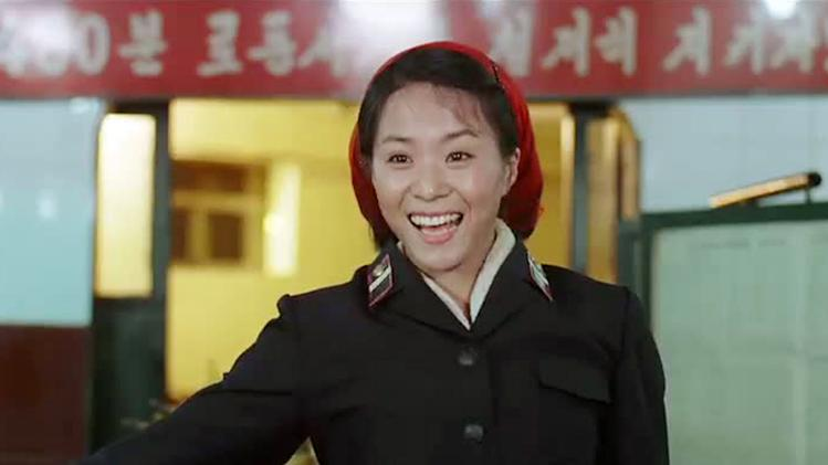 "FILE - In this file image made out of film ""Comrade Kim Goes Flying"" released by Another Dimension of An Idea/Koryo Group, Comrade Kim Yong Mi played by Han Jong Sim acknowledges applause from her comrades for her acrobatic performance. An international film festival opens Thursday, Sept. 20, 2012 in the unlikeliest of places: North Korea. This year's festival includes movies from Britain, Germany and elsewhere. But not America. Festivalgoers will get to see two feature films in North Korea but edited overseas: the romantic comedy ""Comrade Kim Goes Flying,"" a joint North Korean-European production, and ""Meet in Pyongyang,"" made in conjunction with a Chinese film studio. (AP Photo/Courtesy of Another Dimension of An Idea/Koryo Group) EDITORIAL USE ONLY"