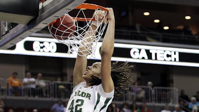FILE - In this March 24, 2012, file photo, Baylor center Brittney Griner dunks the ball during the second half of an NCAA women's tournament regional semifinal college basketball game against Georgia Tech in Des Moines, Iowa. Griner became only the third player to be a two-time unanimous choice on The Associated Press' women's basketball preseason All-America team, receiving all 40 votes from a national media panel Tuesday, Oct. 30. (AP Photo/Charlie Neibergall, File)
