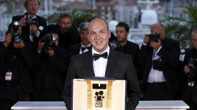 Colombian director Cesar Augusto Acevedo talks on stage after being awarded with the Camera d'Or poses during a photocall after the closing ceremony of the 68th Cannes Film Festival in Cannes