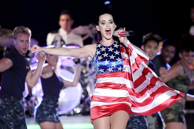 "FILE - In this May 23, 2012 file photo released by Starpix, singer Katy Perry wears a patriotic dress as she performs at a Pepsi-sponsored event at Brooklyn Pier 9A, kicking off Fleet Week in New York. The pop star's energetic Day-Glo performances and chart success _ tying Michael Jackson's ""Bad"" with five No. 1 singles from her album ""Teenage Dream"" _ are undercut by heartbreak in her new 3D concert film ""Katy Perry: Part of Me."" She sobs uncontrollably backstage as her marriage to Russell Brand falls apart during her world tour, and talks about her dashed desire for ""fairy tale"" romance. The film opens nationwide on July 5. (AP Photo/Starpix, Amanda Schwab, file)"