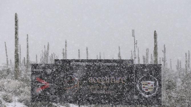 Snow falls on the ninth green at the Match Play Championship golf tournament, Wednesday, Feb. 20, 2013, in Marana, Ariz. Play was suspended for the day. (AP Photo/Julie Jacobson)