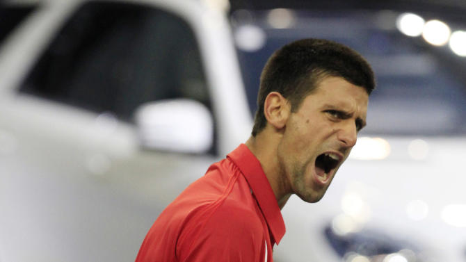 Novak Djokovic of Serbia reacts after winning the first set against Tomas Berdych of the Czech Republic in the men's singles semifinal match at the Shanghai Masters tennis tournament at Qizhong Forest Sports City Tennis Center in Shanghai, China, Saturday Oct. 13, 2012. (AP Photo/Eugene Hoshiko)