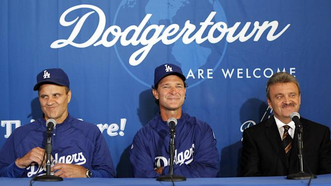 FILE - In this Sept. 17, 2010 file photo, Los Angeles Dodgers hitting coach Don Mattingly smiles during a news conference, flanked by manager Joe Torre, left, and general manager Ned Coletti, right,  where Mattingly was named the Dodgers manager for the 2011 season,  and Torre , it was announced, would step aside,  in Los Angeles. Torre has resigned as Major League Baseball's executive vice president for baseball operations to join a group trying to buy the Dodgers. (AP Photo/Alex Gallardo, File)