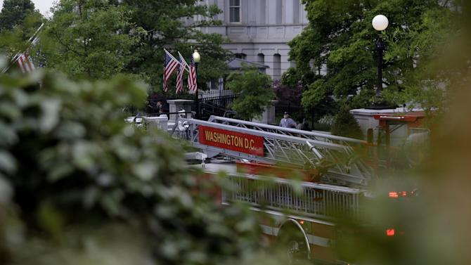 A District of Columbia Fire Department truck is seen parked between the The Eisenhower Executive Office Building and the West Wing as they respond to a call at the White House, Saturday, May 11, 2013, in Washington. The West Wing including the media area were evacuated because of smoke according to Secret Service Uniformed Division. Journalists were sent outside shortly after 7 a.m. while firefighters inspected the West Wing. They were allowed back into the building about an hour later. (AP Photo/Carolyn Kaster)