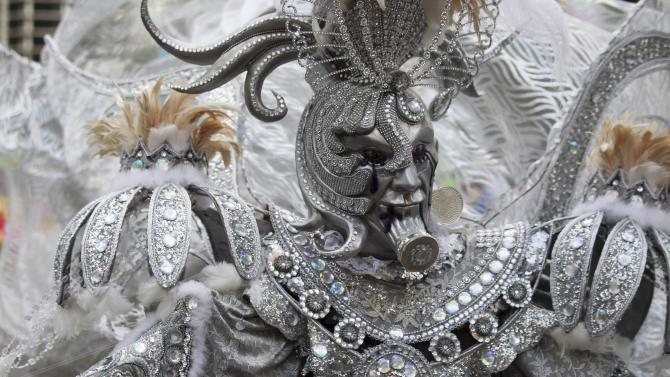 A costumed performer takes part in an event marking the closing of national carnival celebrations in the Malecon of Santo Domingo