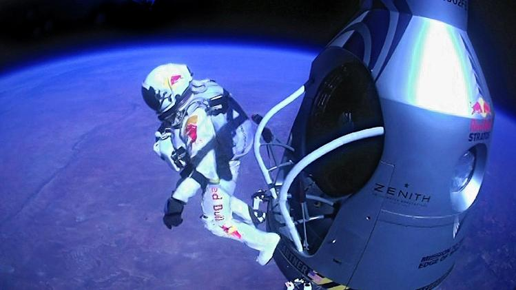 Oct. 14, 2012 file image provided by Red Bull Stratos shows pilot Felix Baumgartner of Austria as he jumps out of the capsule during the final manned flight for Red Bull Stratos. In a giant leap from more than 24 miles up, Baumgartner shattered the sound barrier Sunday while making the highest jump ever ó a tumbling, death-defying plunge from a balloon to a safe landing in the New Mexico desert. (AP Photo/Red Bull Stratos)