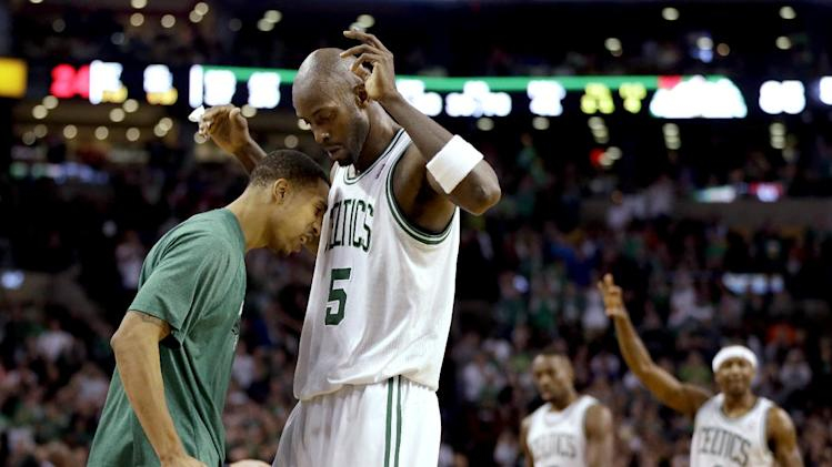 Boston Celtics guard Courtney Lee, left, and forward Kevin Garnett (5) celebrate on the sideline after a score against the Miami Heat as forward Jeff Green (8) and guard Jason Terry (4) walk up during the fourth quarter of an NBA basketball game at TD Garden in Boston, Sunday, Jan. 27, 2013. The Celtics won 100-98 in double overtime. (AP Photo/Steven Senne)