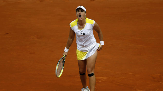 Anabel Medina from Spain reacts during her game against Serena Williams from U.S. during the Madrid Open tennis tournament, in Madrid,  Friday, May 10, 2013. (AP Photo/Daniel Ochoa de Olza)