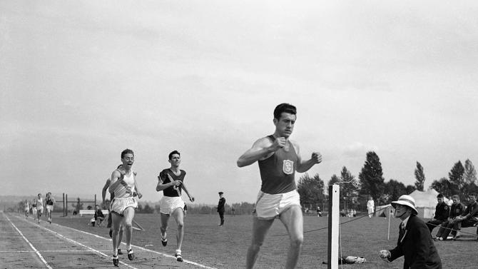 FILE - In a May 20, 1939, file photo, Louis Zamperini, of the University of Southern California, breaks the tape and record with a time of 4:16.3 to win the mile run in the Pacific Coast Conference Track and Field meet the University of Washington Stadium in Seattle. Zamperini, a U.S. Olympic distance runner and World War II veteran who survived 47 days on a raft in the Pacific after his bomber crashed, then endured two years in Japanese prison camps, died on July 2, 2014. He was 97. He credited sports, boxing as a boy to deal with bullies, later the discipline of running - with his survival. (AP Photo/Paul Wagner, File)