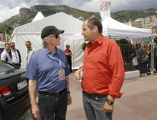 American actor Michael  Douglas, left, talks with former Formula One driver Gerhard Berger, of Austria, at the Monaco racetrack, in Monaco, Saturday, May 25, 2013. The formula one race will be held on