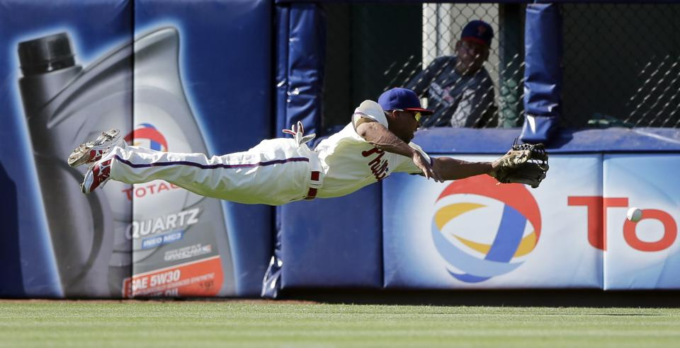 Philadelphia Phillies center fielder Ben Revere cannot reach a double by Milwaukee Brewers' Logan Schafer in the fourth inning of a baseball game, Saturday, June 1, 2013, in Philadelphia. Aramis Ramirez was thrown out at home trying to score and Schafer advanced to third on the play. (AP Photo/Matt Slocum)