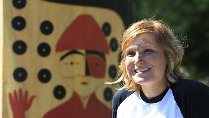 Heather Purser, a Suquamish tribal member who worked to change the tribes marriage ordinance to include same-sex couples, stands near a memorial for Chief Seattle on the tribe's reservation Tuesday, Aug. 2, 2011, in Suquamish, Wash. The change in tribal law came after a four-year campaign by Purser, 28, to get the American Indian Tribe in Washington state to adopt a law recognizing gay marriage. The Suquamish Tribal Council voted Monday, Aug. 1, to extend marriage rights to same-sex couples on its reservation near Seattle, making it only the second tribe in the country known to do so. (AP Photo/Elaine Thompson)