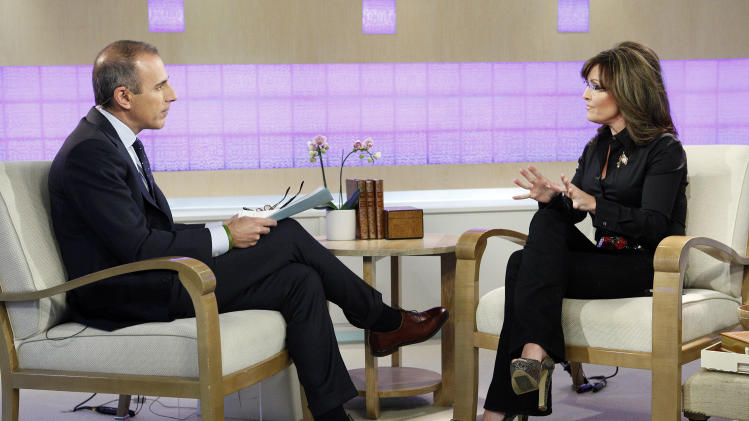 """Today"" show co-host Matt Lauer and guest co-host, Sarah Palin, talk on the show's set in New York on Tuesday, April 3, 2012. Palin was the much-hyped guest co-host on NBC's ""Today,"" going head-to-head against former ""Today"" anchor Katie Couric, who this week is subbing on ""Good Morning America"" at her current workplace, ABC. (AP Photo/NBC, Peter Kramer)"