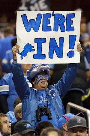 A fan holds a sign for the Detroit Lions making the playoffs in the third quarter of an NFL football game against the San Diego Chargers in Detroit, Saturday, Dec. 24, 2011. Detroit won 38-10 to clinch a playoff spot. (AP Photo/Rick Osentoski)