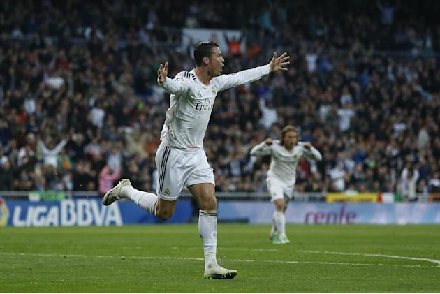Real's Cristiano Ronaldo celebrates his goal during a Spanish La Liga soccer match between Real Madrid and Levante at the Santiago Bernabeu stadium in Madrid, Spain, Sunday, March 9, 2014